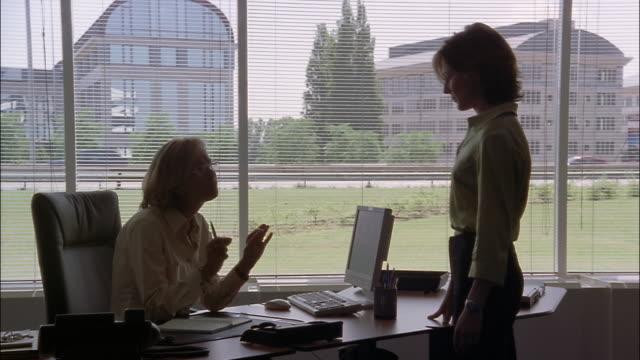 An executive reprimands an employee.