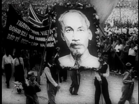 an exhibit about the vietnamese struggle for independence is visited my school children / children pass by portraits of chairman mao joseph stalin... - mao stock videos and b-roll footage