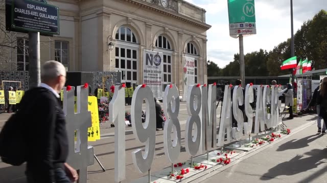 vídeos de stock, filmes e b-roll de an exhibition and rally was held on september 29 at the place de la bastille in paris to honor the victims the 1988 massacre of 30000 political... - bastille