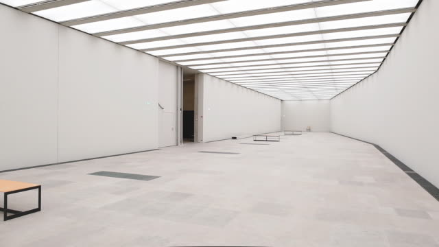 an exhibition hall stands inside the nearlycompleted james simon gallery on july 01 2019 in berlin germany the james simon gallery designed by... - museum stock-videos und b-roll-filmmaterial