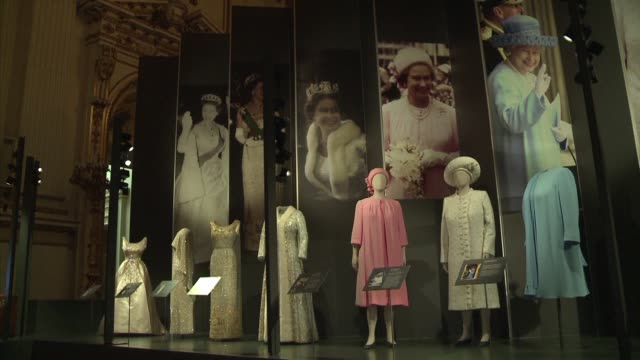 an exhibition of queen elizabeths dresses including her finely embroidered coronation dress by british couturier norman hartnell are on display at... - coronation stock videos and b-roll footage