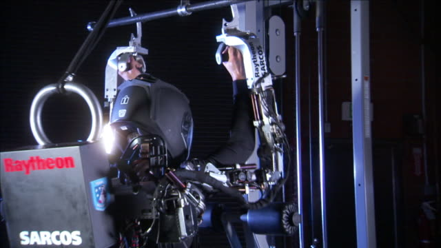 an exoskeleton pilot lifts heavy weights with ease. - exoskeleton stock videos & royalty-free footage