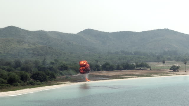 An explosion and helicopter the beach head during the ongoing USThai joint military exercise titled Cobra Gold on Hat Yao beach in Chonburi province...