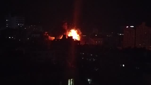 an explosion as an israeli air strike hits gaza city on may 5 2019 - luftangriff stock-videos und b-roll-filmmaterial