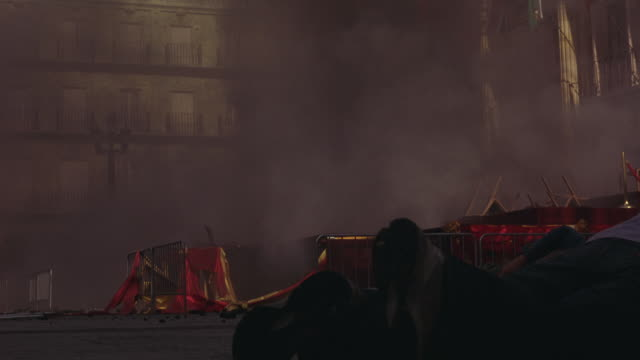 an explosion at the plaza mayor injures nearby people. - injured stock-videos und b-roll-filmmaterial