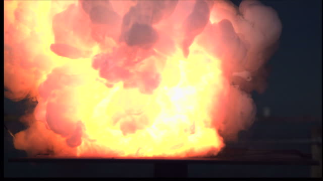 an explosion creates a massive fireball. - fireball stock videos & royalty-free footage