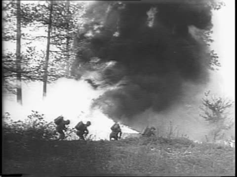 an explosion goes off in the woods / troops running up to the explosion with their flamethrowers / a closer view of the troops using their... - narrating stock videos & royalty-free footage