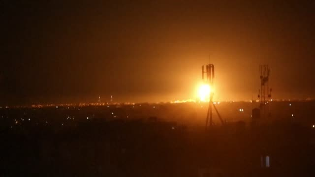 an explosion is seen in the distance in rafah city, as the israeli army targets several sites affiliated with hamas in the southern gaza strip - air raid stock videos & royalty-free footage