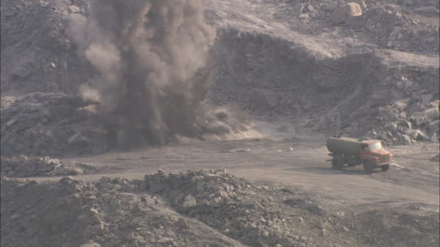 an explosion occurs near a truck at a coal mine. - mine stock videos & royalty-free footage