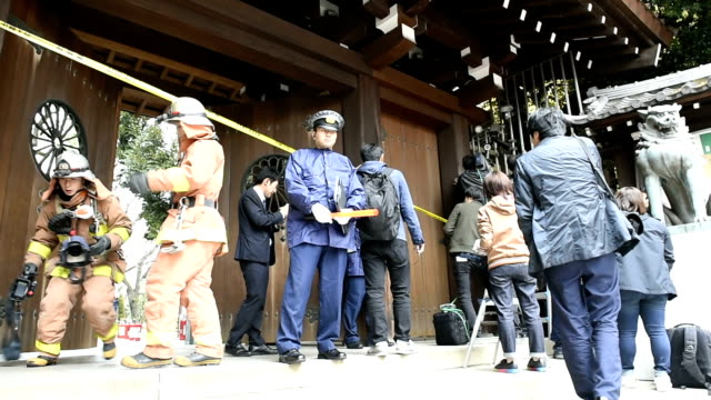 an explosion was heard at a public restroom at the warlinked yasukuni shrine in tokyo on monday morning causing no injuries but prompting police to... - shinto stock videos & royalty-free footage