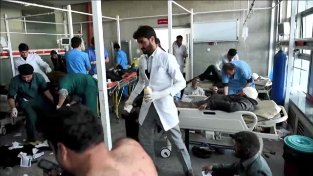 An explosives packed ambulance blew up in a crowded area of Kabul on Saturday killing at least 63 people and wounding 151 others officials said in...
