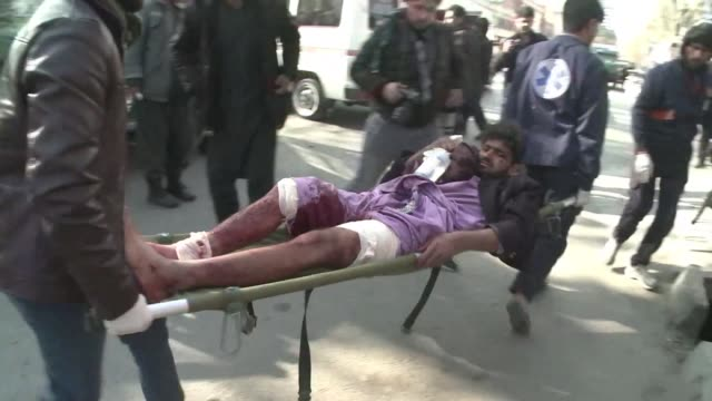 an explosives packed ambulance blows up in a crowded area of kabul killing at least 95 people and wounding 158 others in one of the biggest blasts to... - kabul stock videos & royalty-free footage