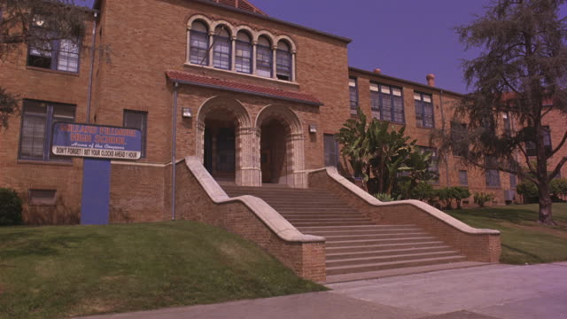 stockvideo's en b-roll-footage met an exterior view of a high school campus. - school building