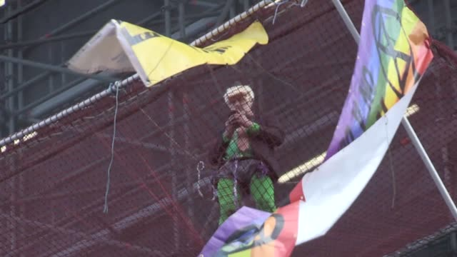 an extinction rebellion protester has scaled the side of big ben the protester is wearing a blonde wig and has unfurled a flag of the side of the... - blonde hair stock videos & royalty-free footage