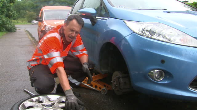 an extra £1 billion a year could be spent on fixing potholes and other road maintenance if the government invested two pence per litre of existing... - 水場点の映像素材/bロール