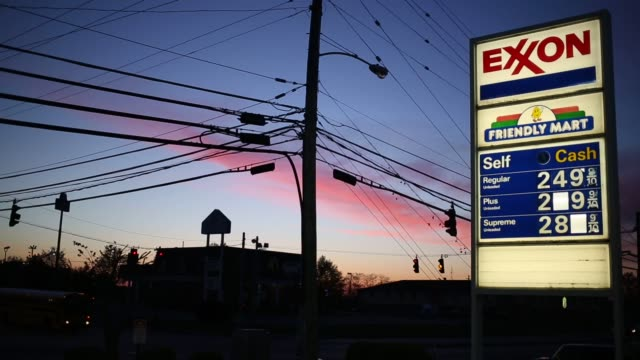 an exxonmobil gas station stands in richmond kentucky us as the sun rises on wednesday april 29 2015 shots night time shots of an exxonmobil gas... - exxon stock videos & royalty-free footage