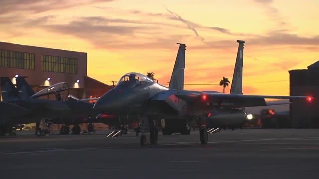 An F15 assigned to the 65th Aggressor Squadron 57th Wing at Nellis Air Force Base Nev taxis in for final checks before takeoff during Red Flag 143...