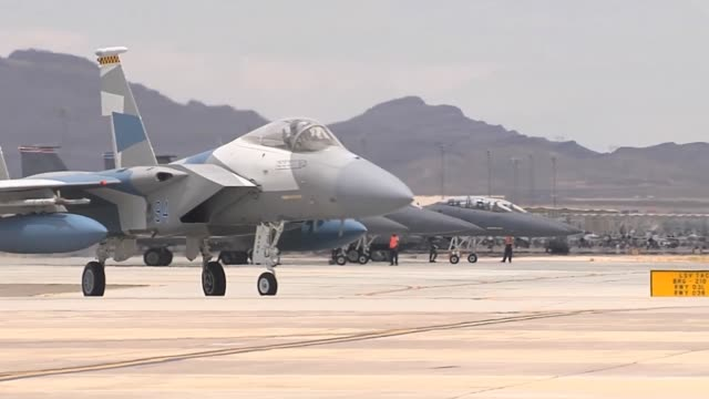 An F15 assigned to the 65th Aggressor Squadron 57th Wing at Nellis Air Force Base Nev taxis towards the runway during Red Flag 143 Jul 16 2014 RED...