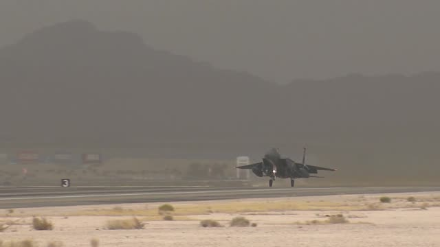 An F15 Eagle assigned to the 65th Aggressor Squadron at Nellis Air Force Base Nev takes off during Red Flag Red Flag operations on Nellis Air Force...