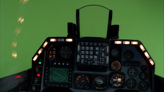 an f16 cockpit with a green screen background simulates a smooth flight. - air vehicle stock videos & royalty-free footage