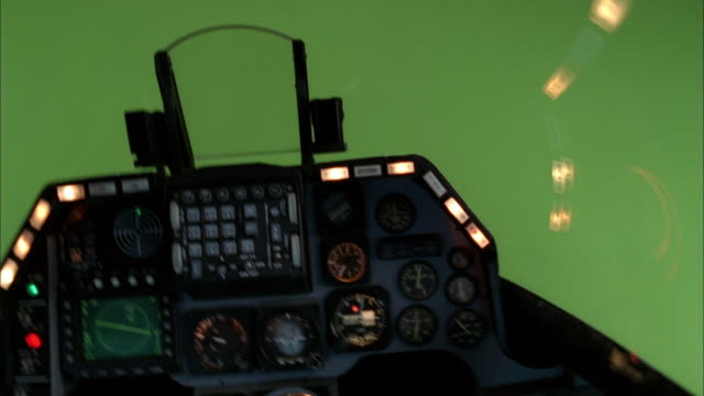 an f16 cockpit with a green-screen background experiences turbulence as instrument panel lights flash. - chroma key stock videos & royalty-free footage