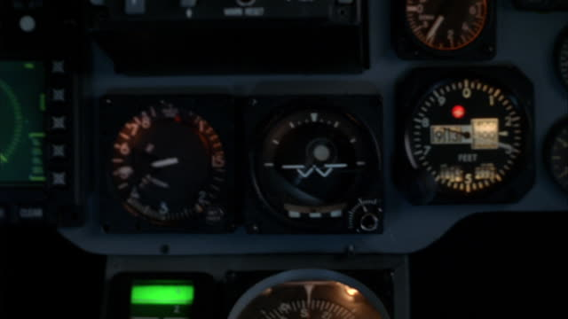 an f16 cockpit with a green-screen background shakes as dials spin and lights flash on the instrument panel. - cockpit stock videos & royalty-free footage