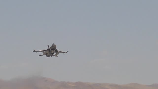 vídeos de stock, filmes e b-roll de an f16c fighting falcon assigned to the 64th aggressor squadron 57th wing at nellis air force base nev takes off during red flag 143 jul 24 2014 the... - nellis air force base