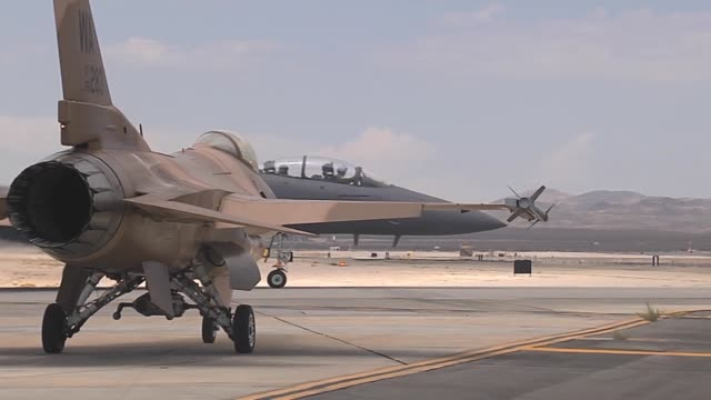 vídeos de stock, filmes e b-roll de an f16c from the 64th aggressor squadron 57th wing at nellis air force base nev waits for an f15e from the 494th fighter squadron 48th fighter wing... - nellis air force base