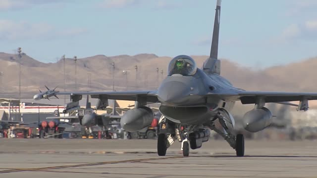 . an f-16cm assigned to the 4th fighter squadron at hill afb, utah, taxis towards the runway during red flag 14-2 mar 7, 2014 at nellis afb, nev. it... - us airforce stock videos & royalty-free footage