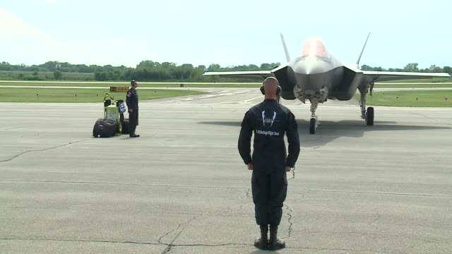 an f-35 fighter jet lands at the gary/chicago international airport before the 2016 chicago air and water show. - chicago air and water show stock videos & royalty-free footage