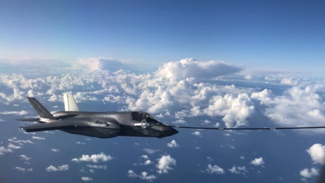 an f-35b combat aircraft from the royal air force refuels from an raf voyager aircraft over the north sea on october 08, 2020 in flight, above... - raf stock videos & royalty-free footage