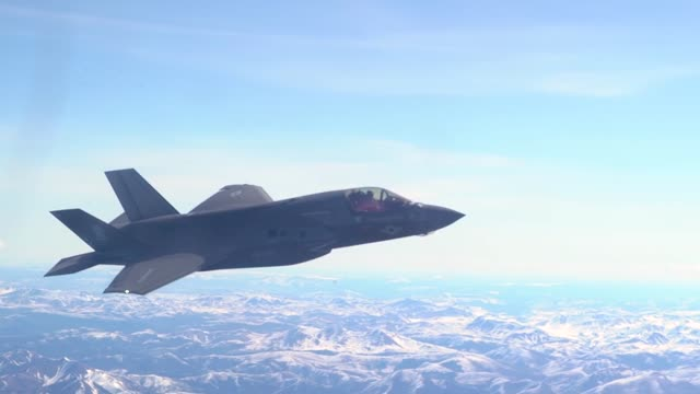 an f-35b lightning ii conducts aerial refueling with a kc-130j hercules above alaska during exercise northern edge. - fighter stock videos & royalty-free footage