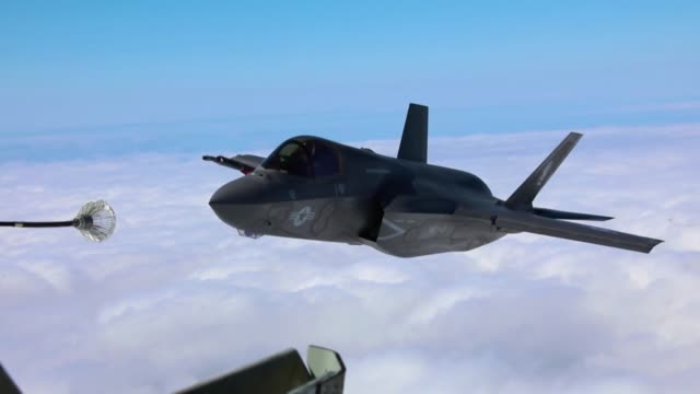 an f35b lightning ii stealth fighter conducts an aerial refueling mission with a drogue attached to a kc135 stratotanker above the south china sea - refueling stock videos & royalty-free footage