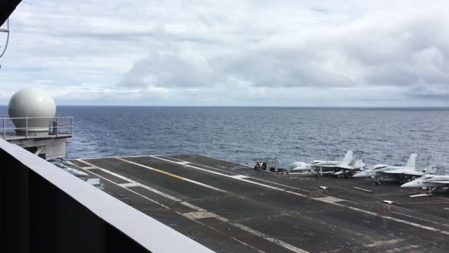an f/a-18 hornet lands during a joint military exercise, saxon warrior, aboard the uss george h.w. bush on august 6, 2017 off the north west coast of... - aircraft carrier stock videos & royalty-free footage