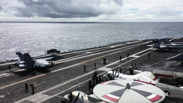 stockvideo's en b-roll-footage met an f/a-18 hornet takes off during joint military exercise, saxon warrior, aboard the uss george h.w. bush on august 6, 2017 off the north west coast... - british military