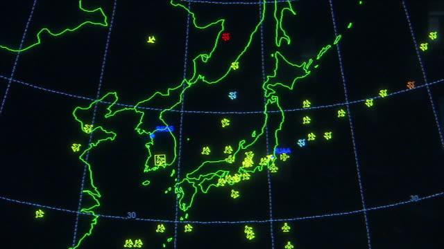 an faa radar screen displays the motions of aircraft over japan, south korea, north korea, and china. - radar stock videos & royalty-free footage