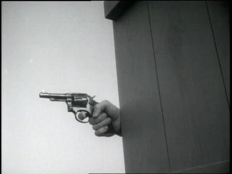 an fbi agent shoots a pistol from behind a wall - handgun stock videos & royalty-free footage