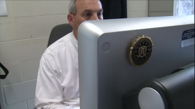 an fbi agent works at his desk. - fbi stock videos & royalty-free footage