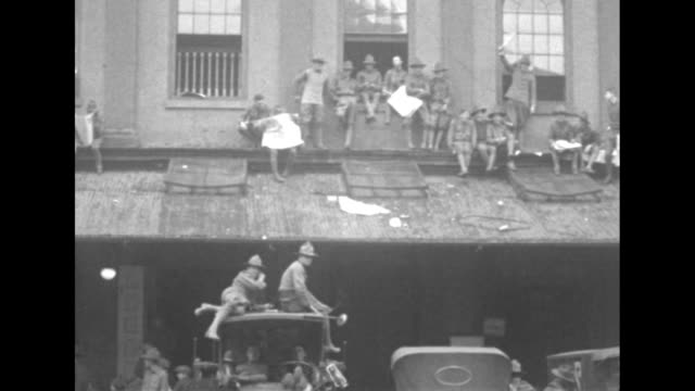 an group of ma national guardsmen on the roof of a building with one waving a newspaper at the camera / note: exact day not known - newspaper strike stock videos & royalty-free footage