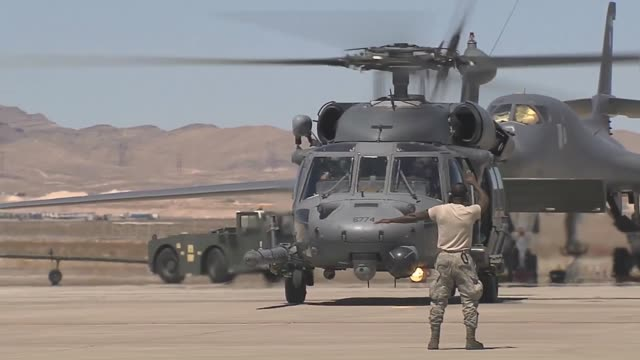 vídeos de stock, filmes e b-roll de an hh60 pavehawk aircraft assigned to the 66th rescue squadron 23rd wing at nellis air force base nev taxis out for takeoff during red flag 143 jul... - nellis air force base