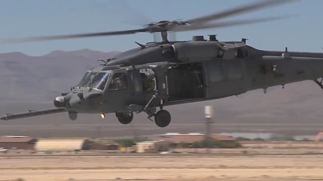 vídeos de stock, filmes e b-roll de an hh60 pavehawk aircraft from the 66th rescue squadron 23rd wing at nellis air force base nev takes off during red flag 143 jul 22 2014 the concept... - nellis air force base
