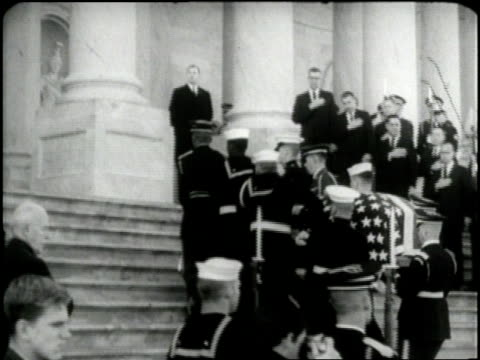 an honor guard carries the flag-draped coffin of u.s. president john f. kennedy up the steps of the capitol building. - coffin stock videos & royalty-free footage