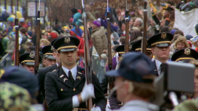 an honor guard precedes a float in a new orleans mardi gras parade - festwagen stock-videos und b-roll-filmmaterial