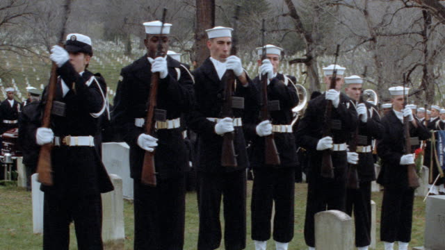 an honor-guard executes a 21-gun-salute at a military funeral. - military stock videos & royalty-free footage