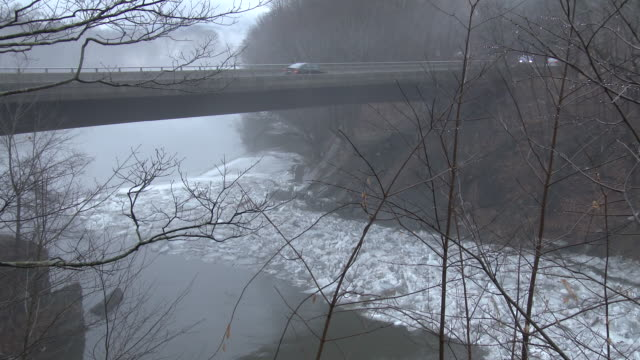 An ice jam begins to form along the Housatonic River in New Milford Connecticut as thick fog slowly rolls over the landscape