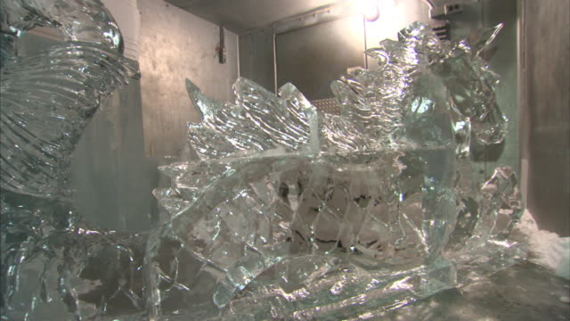 An ice sculpture in a walk-in freezer depicts a unicorn.
