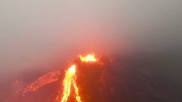 an icelandic photographer captured drone footage of lava flowing from the fagradalsfjall volcano on the reykjanes peninsula on march 20. bjorn... - lava stock videos & royalty-free footage