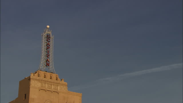 an iconic sign tops the el capitan theater building in hollywood, california. - el capitan theatre stock videos & royalty-free footage