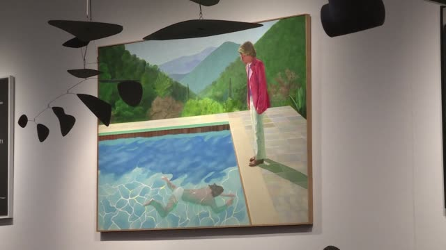 an iconic swimming pool picture painted by british legend david hockney is sold for $903 million in new york smashing a new auction record for a... - auction stock videos & royalty-free footage