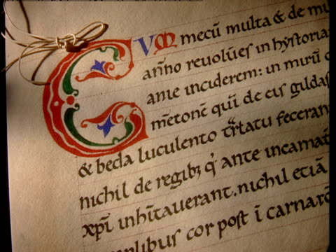 an illuminated letter c marks the beginning of a new section in an ancient document. - letter x stock videos & royalty-free footage